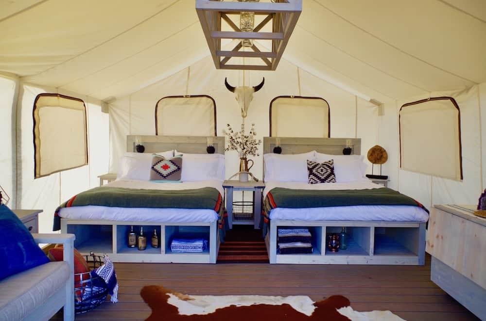 Two queen beds inside Black Tree Resort tent