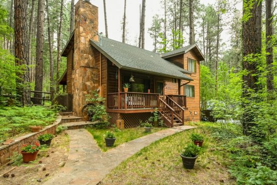 a charming cabin rental in arizona tucked into the woods