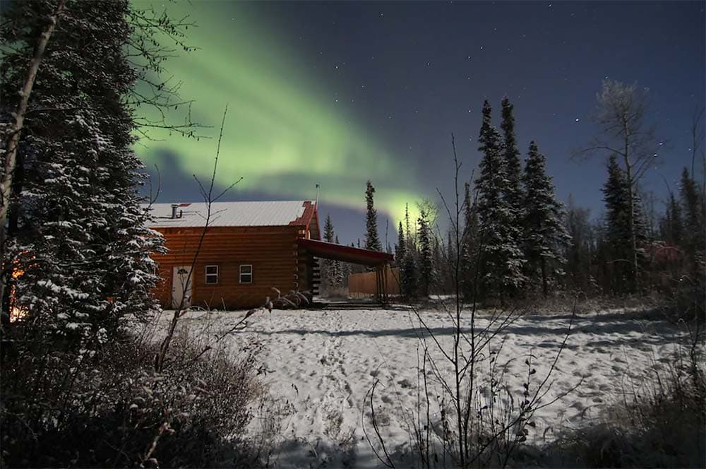 secluded cabin alaska northern lights